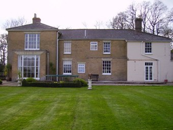 Country house with cracking rendering