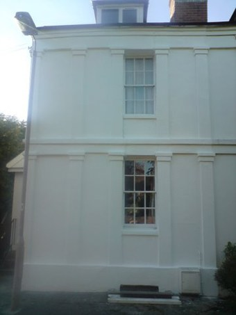 Georgian stucco house painted with a wall coating