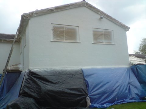masking up a house for wall coating