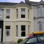 A terraced house in Plymouth painted with a wall coating
