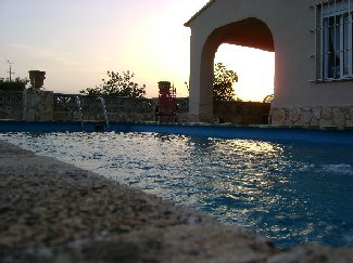 View of house in Torrent valencia spain from pool edge at sunset