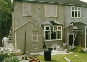 Prep stages of wall coating a house in London