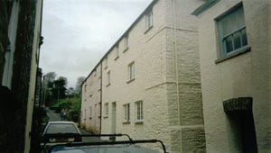 Protective wall coating on stone house