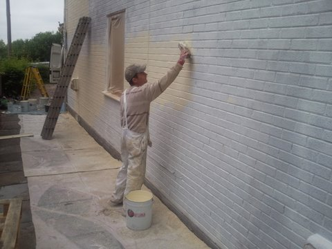 Primer for textured wall coating