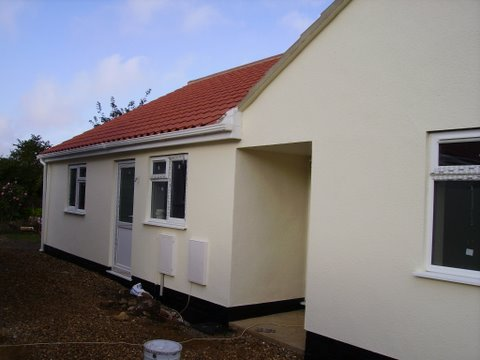Brand new render wall coatings on a house