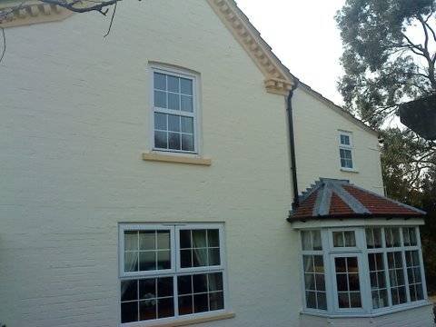 Side of brick cottage with textured wall coverings