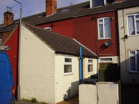 The rear of a terraced house in Manchester before painting work commenced