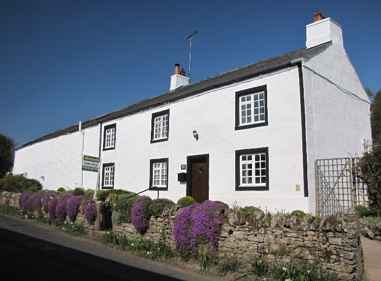 Exterior house painters transform this house in Cumbria