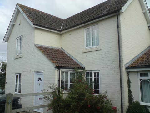 A brick house that needs exterior painting work