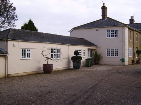 The rear showing the stables with cracked rendering