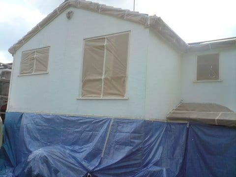 Masking up of the house to spray apply an exterior textured wall coating