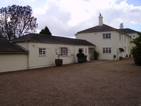 Stable block and rear of house painted