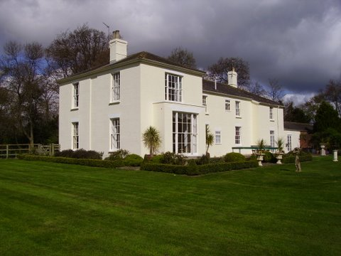 Rendered stately home with a new exterior wall coating!