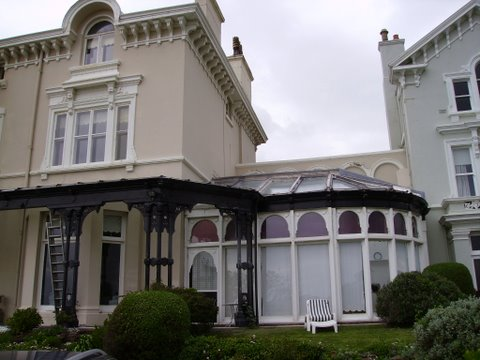Porch and conservatory of listed villa in cheshire