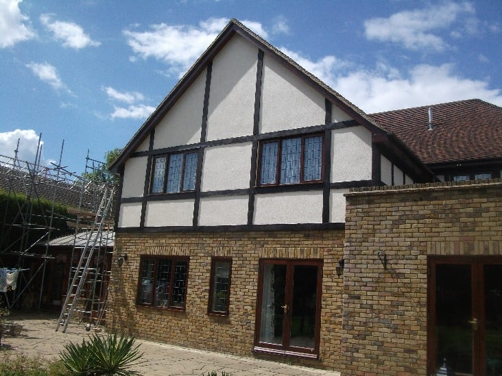 The completed external wall coating job in Surrey