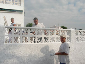 Wall coating team working in the Costa Blanca