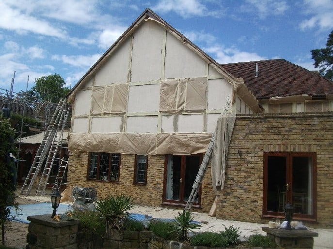 A house in Surrey with masking, ready to be painted