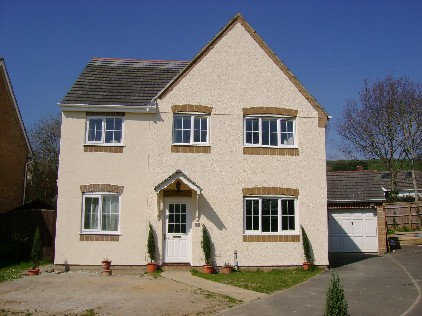 a pebbledashed house AFTER an Exterior Wall coating