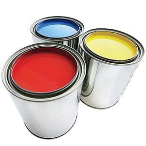 Some tins of paint with the lid off