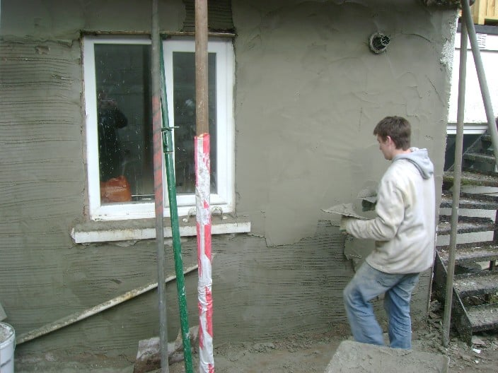 rendering an external wall with sand and cement mortar