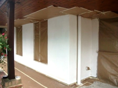 Masking underneath a terrace area ready for the coating