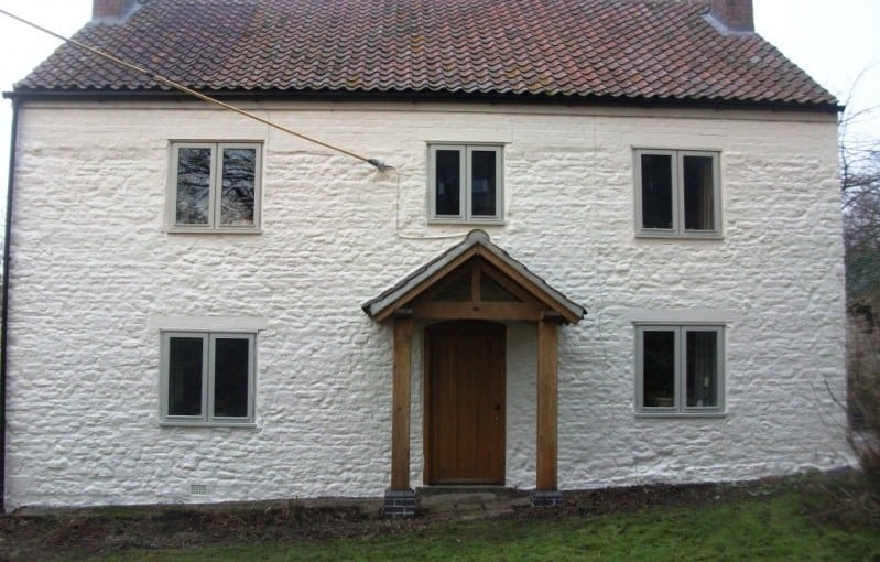A cottage after external wall coating