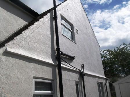 Gable end with a textured wall coating