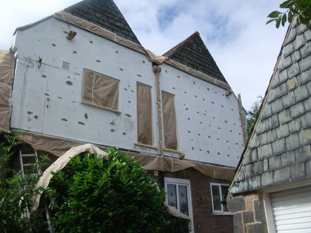 house with cavity wall insulation scars
