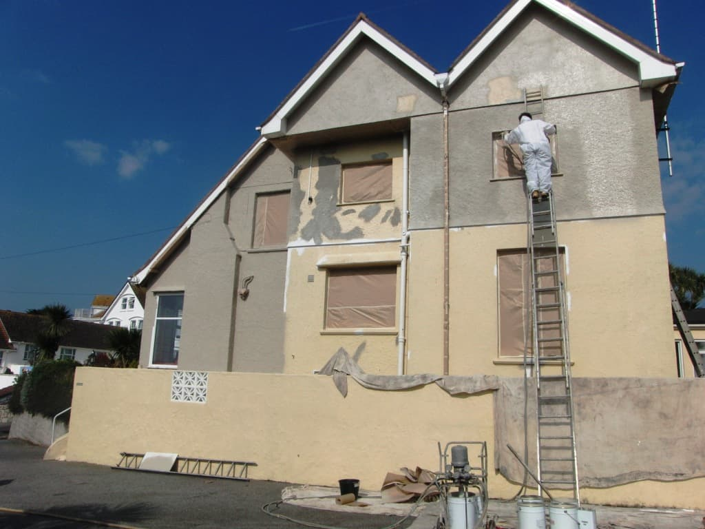 Painting the side of a house in Falmouth Cornwall