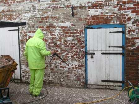 power washing flaky paint before wall repairs