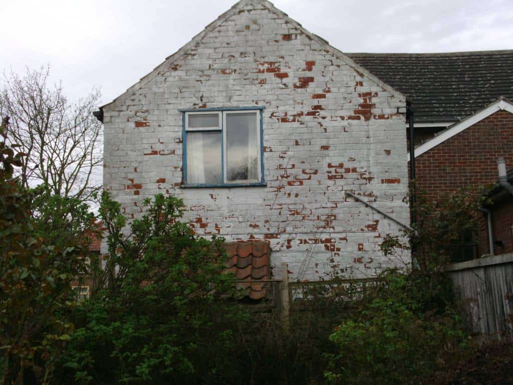 Brickwork in very bad condition with loose pointing and damaged bricks