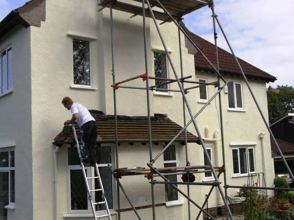 Hand finishing paintwork around doors and windows
