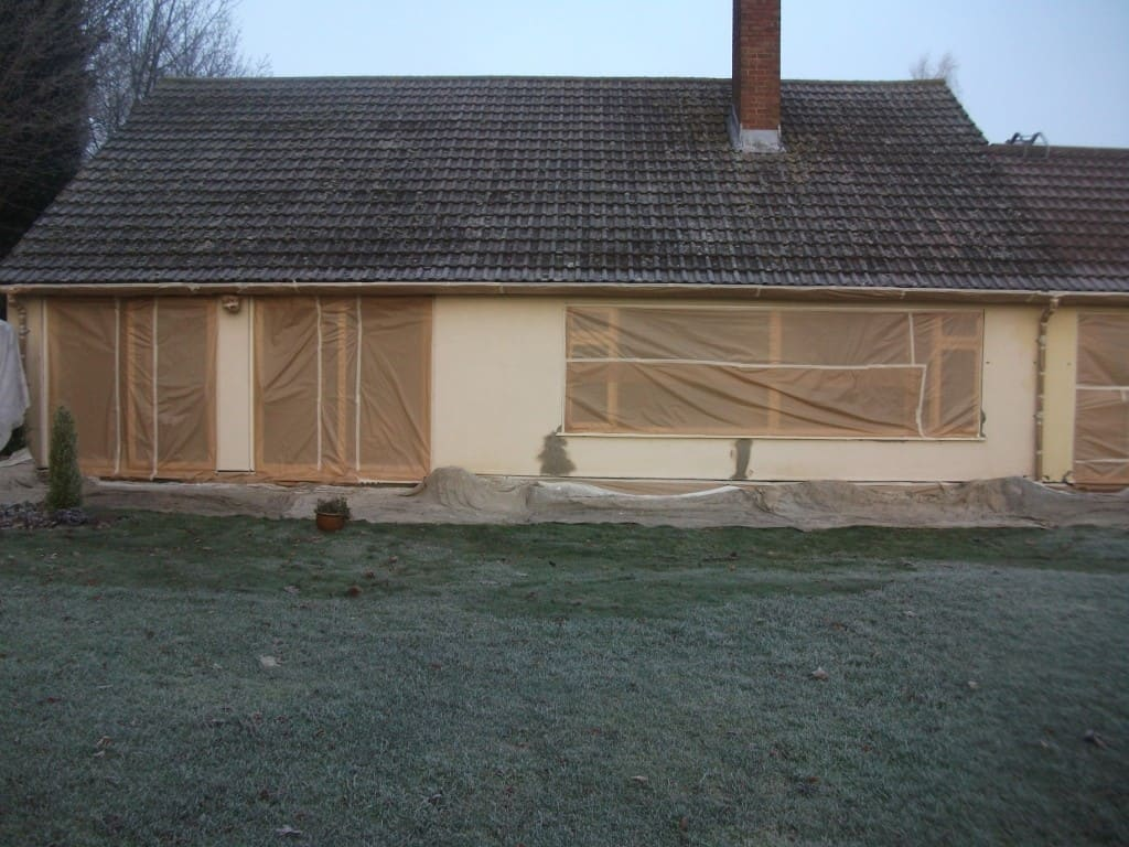 The house masked up, cracks repaired