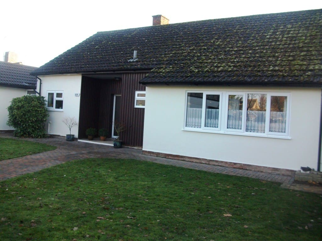 side of bungalow painted with external wall coating