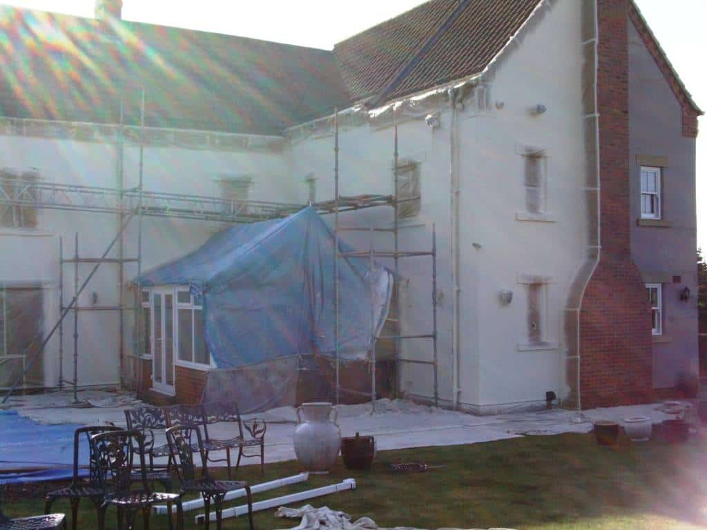 In the middle of the paint spraying work on the render