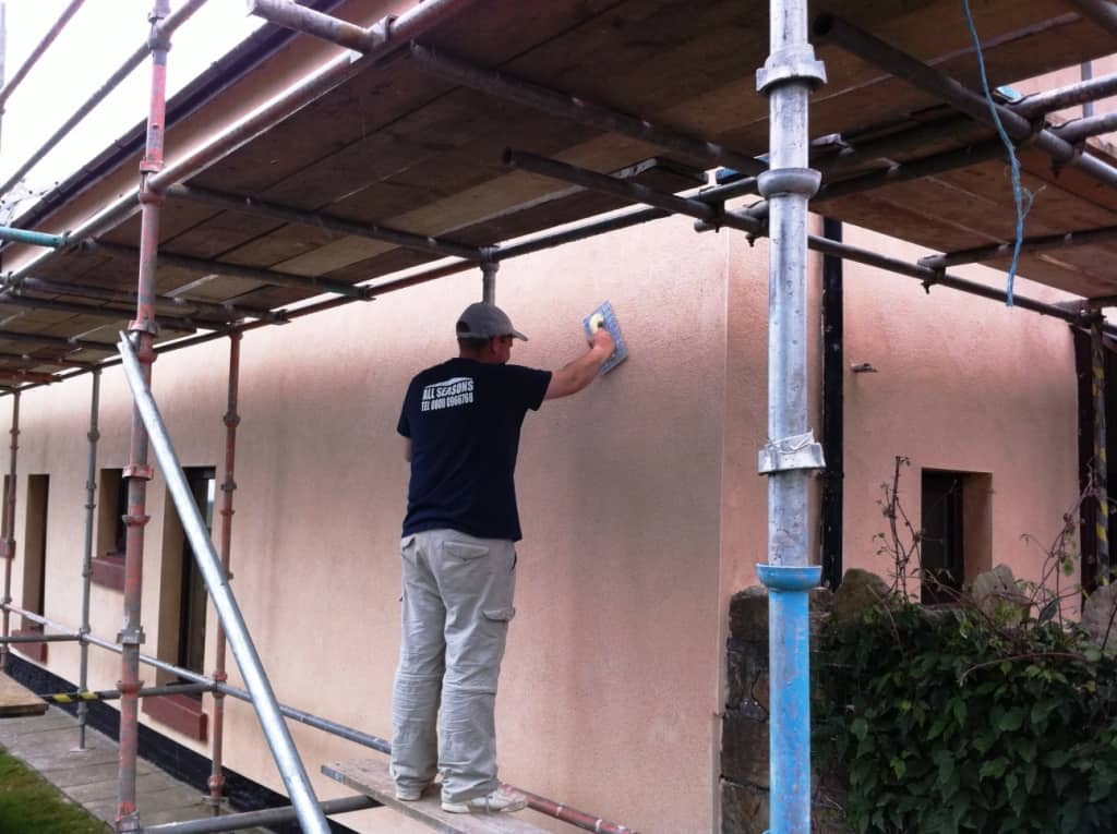 Applying a coloured through render to the house
