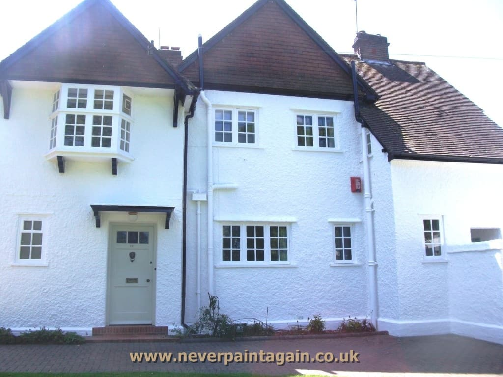 A house in Gloucester painted with NEVER PAINT AGAIN wall coatings