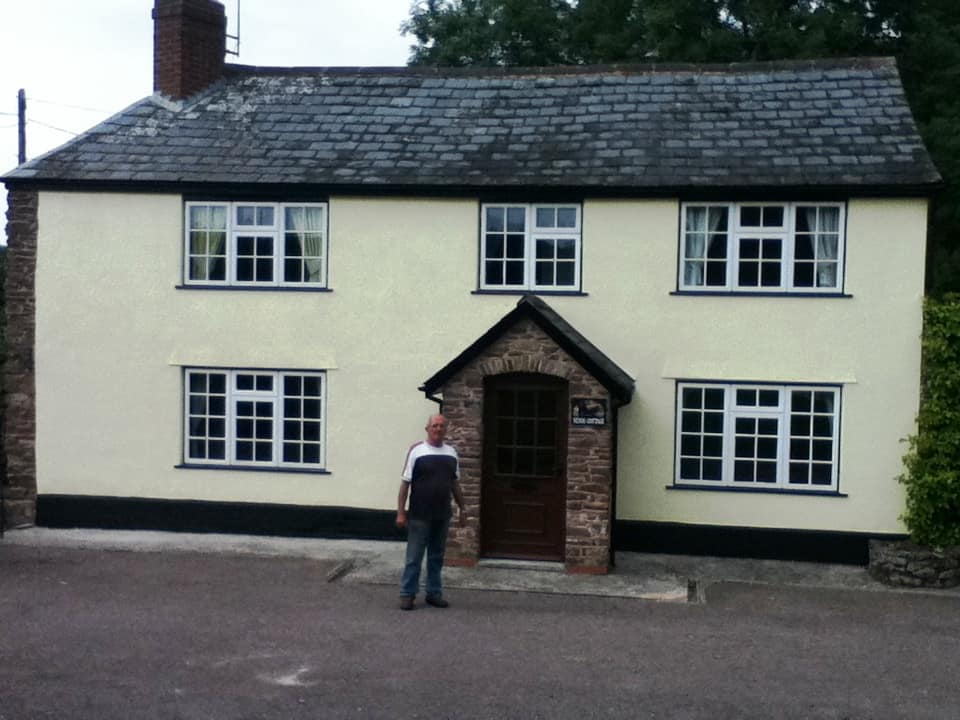 house after painting with happy customer