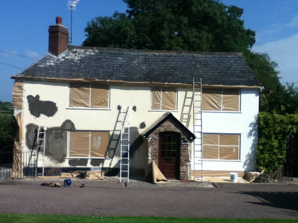 Repaired render patched and applying primer