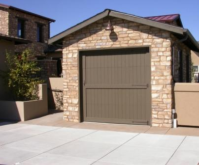 garage with cladding and hard surface driveway