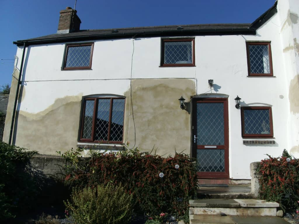 Front of house after render wall covering replacement