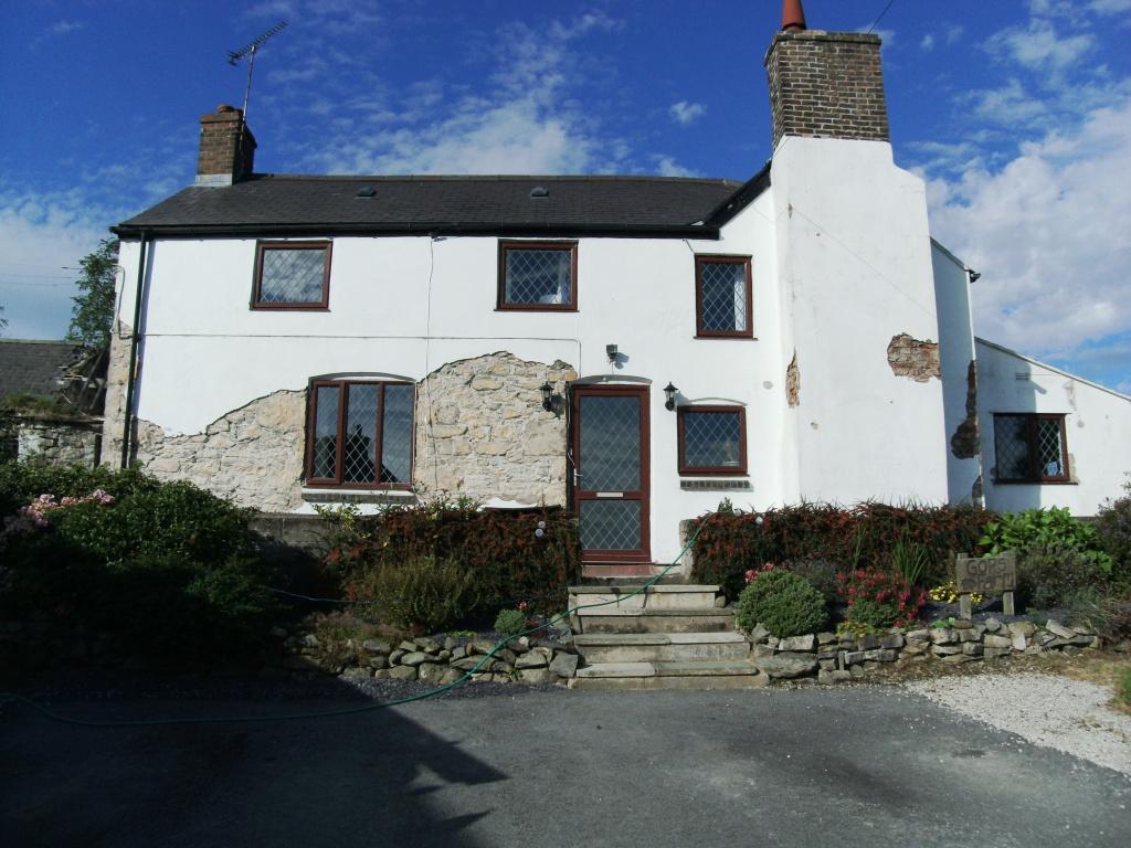Rendering in Wales needed before external home coatings application