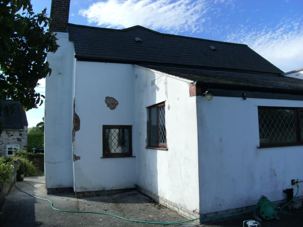 Rear of house with poor, hollow and cracked rendering