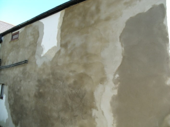 Patch repairs to loose and hollow render by our contractors