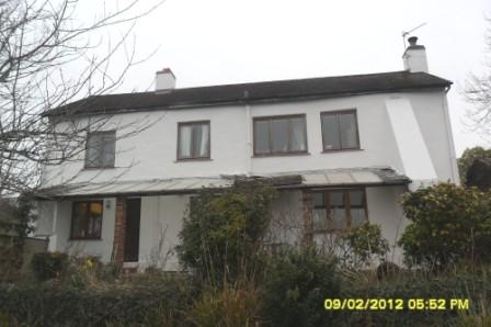 The same elevation of the cottage but now with a white wall coating!