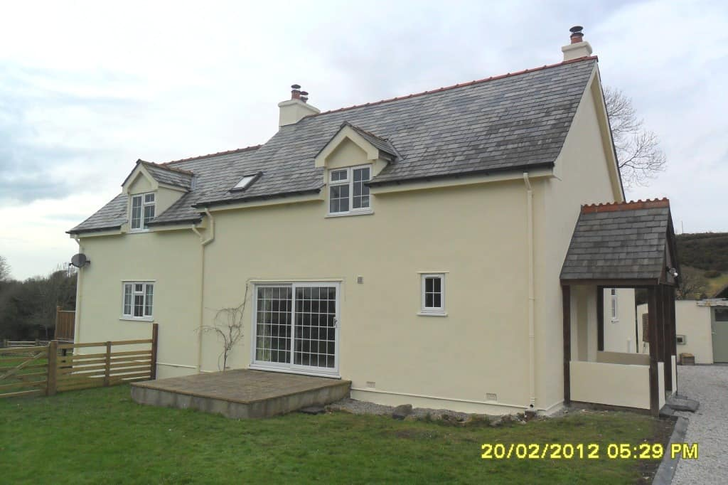 Completed exterior wall coatings and house painting job in Devon