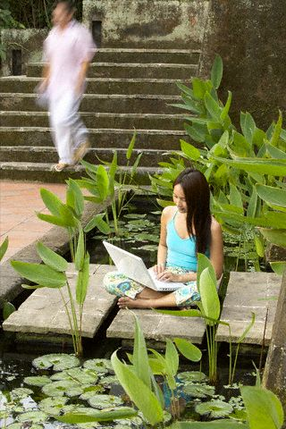 Woman relaxing and on laptop