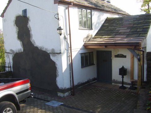Render repairs to the wall of a house