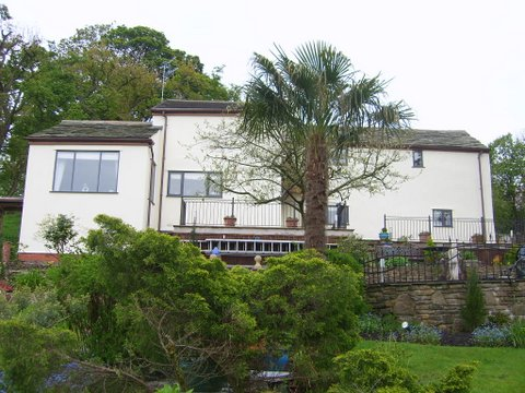 Long shot of rear of house with a tree in the way!