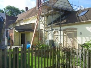 Scaffolding on a sunny day Painting a house in Dorset